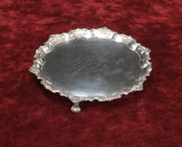 Mappin & Webb silver salver, with a cast pie-crust beaded border upon three scroll feet, engraved to