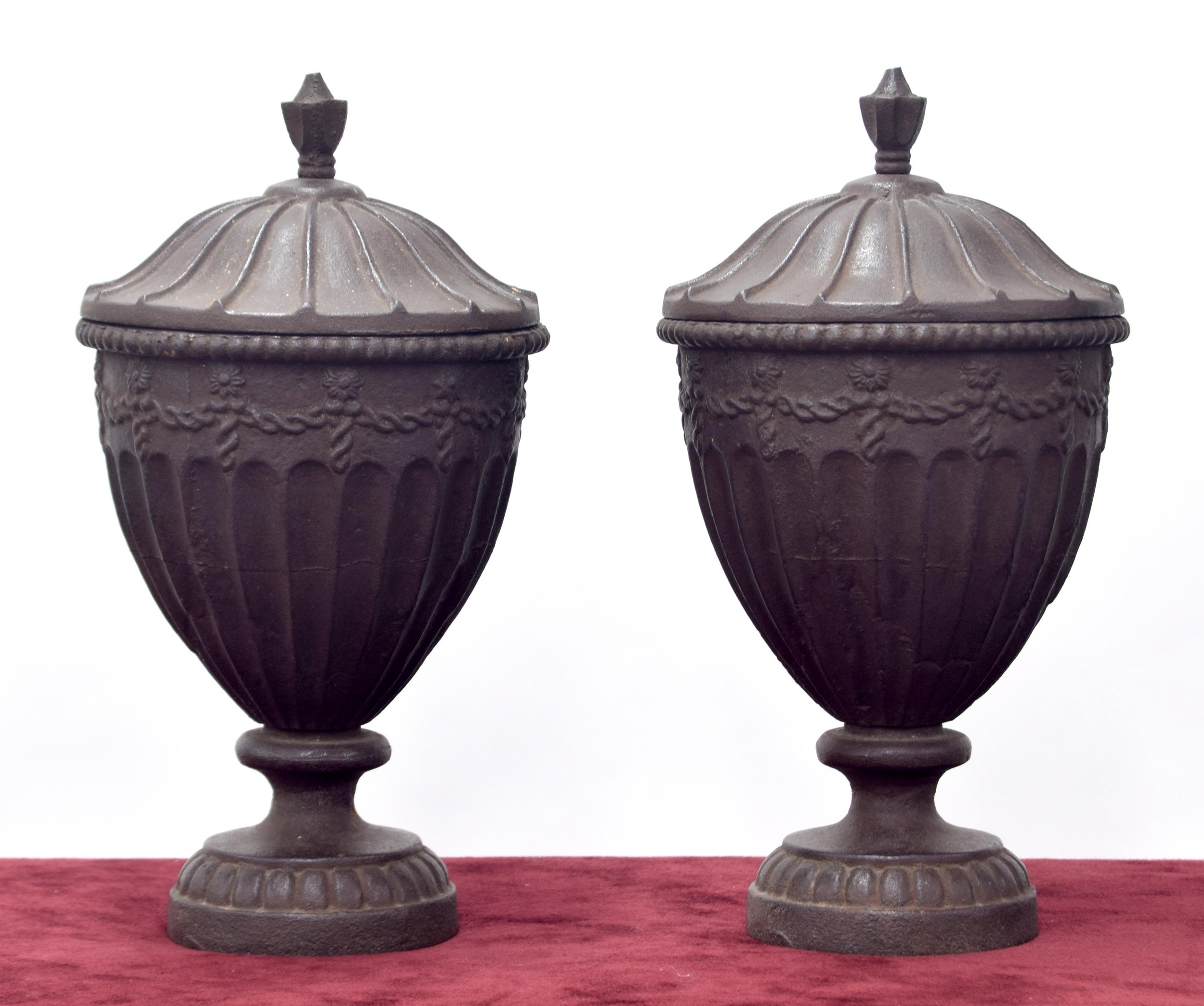 Pair of heavy cast metal urns and covers int he Georgian manner,each with fluted bodies upon