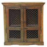 Antique Indian rustic Jali cupboard, with partial painted decoration consisting of two open