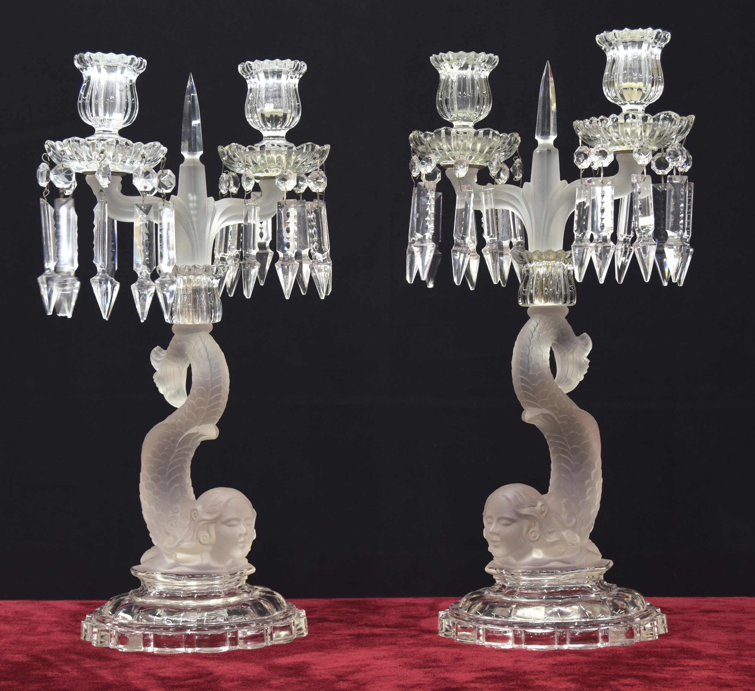 Pair of Baccarat twin-sconce glass candlesticks,the drip-pans with pendant lustre drops upon