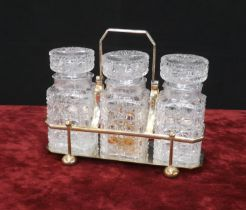 Atkin Brothers silver plated pickle set, inset with three cut-glass jars and stoppers in a plated