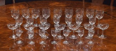 Suite of drinking glasses with engraved floral decoration, possibly Baccarat, comprising seven