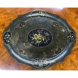 Large Victorian papier maché oval shaped tray, painted with reserves of flowers within gilt