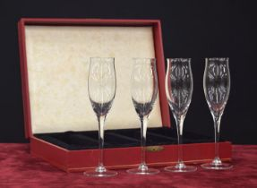 """Set of four Cartier champagne glass flutes in a Cartier box, each signed, 9"""" high"""