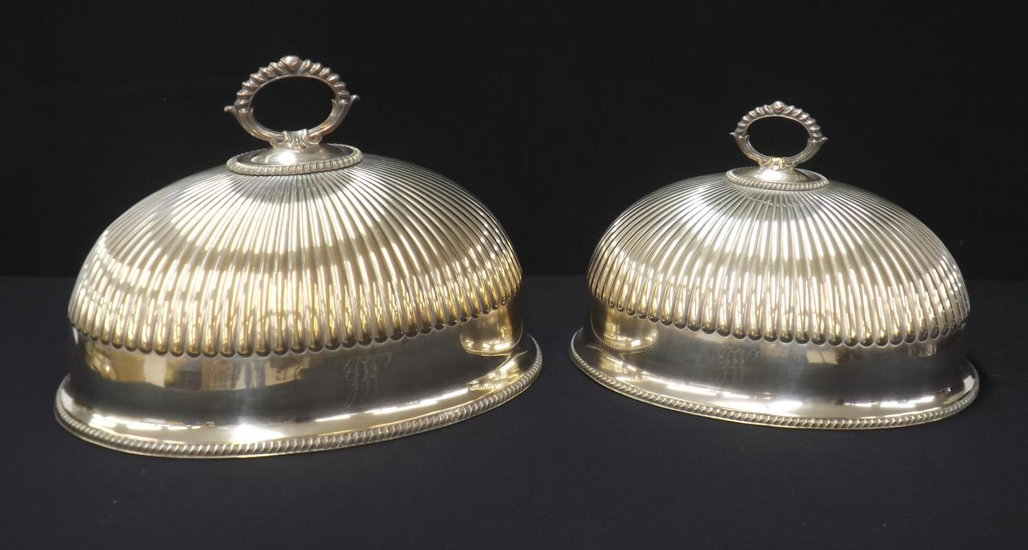 """Matched pair of Sheffield silver plated oval meat covers, maker R. Richardson, 11"""" and 9.5"""" high"""