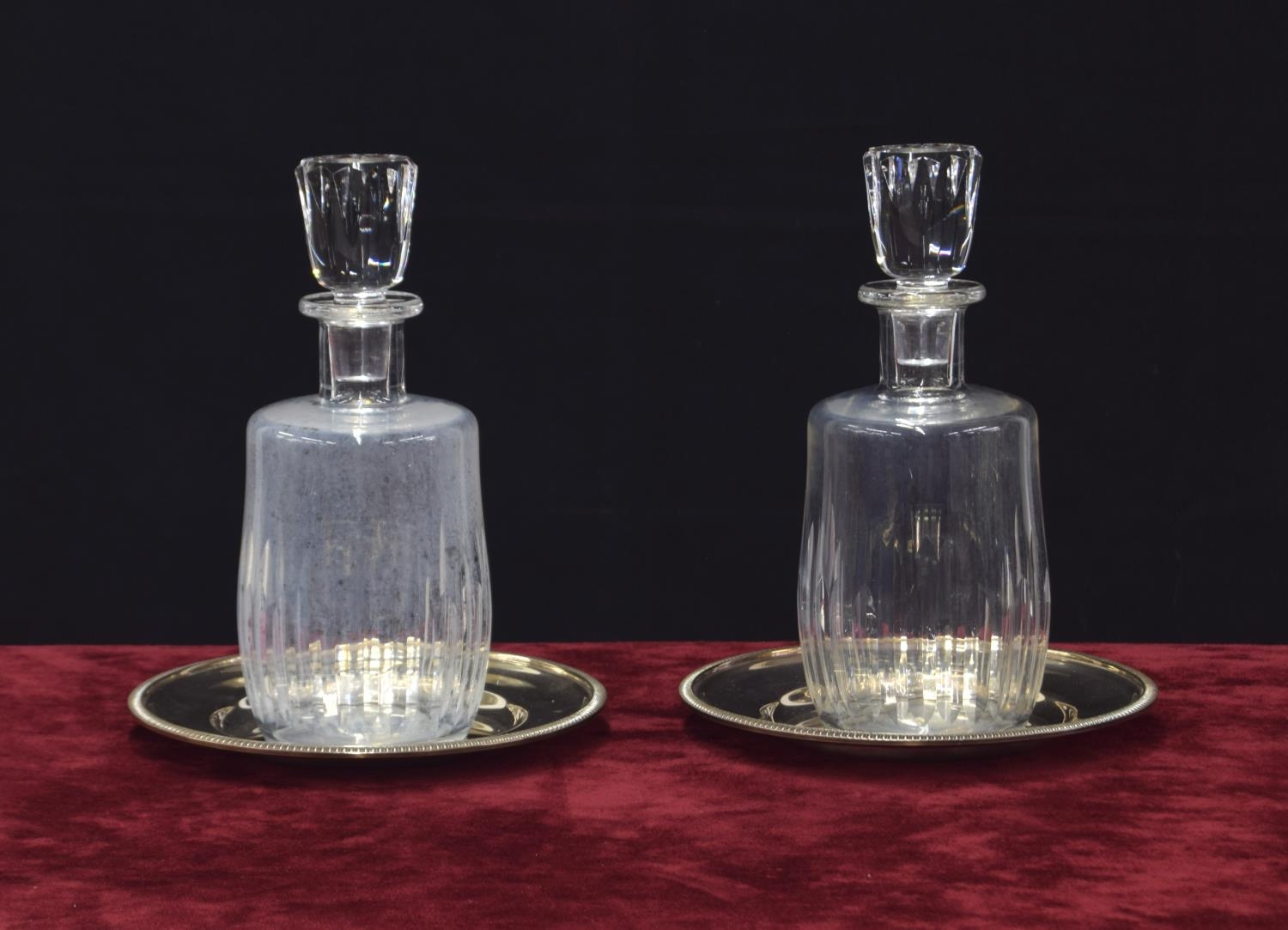 """Pair of Baccarat 'Lorraine' clear glass carafes and stoppers, etched mark, each 10"""" high; mounted"""