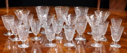 French suite of drinking glasses with scroll designs,possibly Baccarat comprisingfive champagne