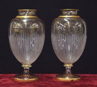 Pair of French glass pedestal vases, possibly Baccarat, with etched and gilded decoration upon