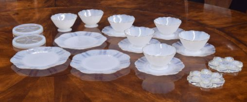 French opalescent glass breakfast set comprising three and six small plates, seven footed bowls, two