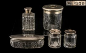 Collection of Silver Topped Glass Jars. Five items in total, fully hallmarked, largest being 9.