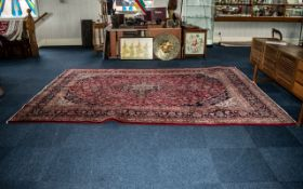 A Large Red Ground Persian Kashan Carpet traditional floral medallion. Measures 356 x 251 cms.