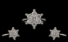 18ct White Gold Superb Quality and Attractive Starburst Diamond Set Ring. The Round Modern Brilliant