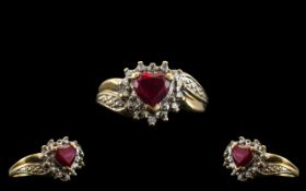 Ladies Attractive 9ct Two Tone Gold Heart Shaped Ruby Set Dress Ring. Full Hallmark for 9 ct - 375.