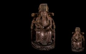 Antique Chinese Finely Carved Cherrywood Figure of a Seated Mandarin wearing a traditional hat