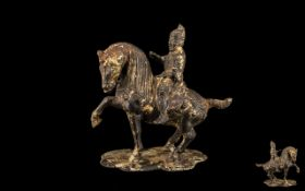 Antique Chinese Bronze Figure. Chinese warrior on horseback, good patina and age related wear.