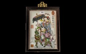 Chinese Famille Rose Decorated Porcelain Tile, depicting a small boy riding a Kylin Dog, with an