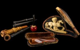 Assorted Collectibles comprising pipes, amber cheroot, etc., good mixed lot a/f.