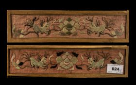 Pair of Antique Chinese Coat Cuff embroidered panels depicting a pair of Shishi dogs amongst