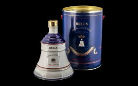 Bell's Old Scotch Whiskey in Commemorative Tin containing Bell's whiskey decanter in porcelain