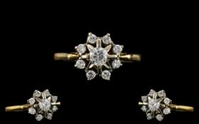 18ct Gold and Platinum Attractive Diamond Set Cluster Ring of Pleasing Design. The Larger Central