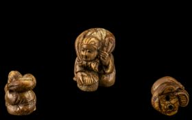 Japanese Netsuke Carved in the Form of a Man carrying a sack. Please see images.