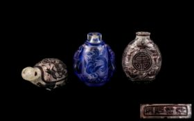 Three Chinese Antique Cameo Cut Snuff Bottles, all signed and depicting dragons, birds, bats and