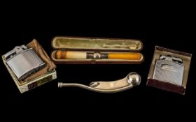 Miscellaneous Lot comprising two vintage Ronson chrome cased petrol lighters, bosun's whistle and