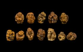 A Collection of Twelve Resin Netsukes including figures and animals.