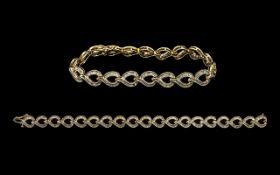 Ladies - Attractive 10ct Gold Baguette Diamond Set Tennis Bracelet of Contemporary Design. Marked