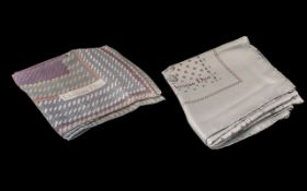 Two Christian Dior Silk Scarves. Both scarves with grey background, hand rolled and stitched hems.