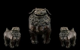 Antique Chinese Ming Period Bronze Censor in the form of a Temple dog, with traces of gilding.
