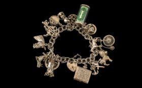 Heavy Silver Charm Bracelet. Charm Bracelet Loaded with Interesting Charms.