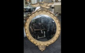 Large and Impressive Reproduction Regency Style Gilded Resin Mirror, crowned with an eagle, above