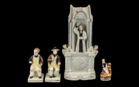 Staffordshire 'Clock' Figure of John Wesley, 12 inches (30 cms) high,