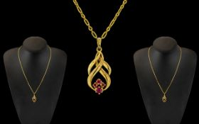 Ladies 9ct Gold - Attractive Pendant Drop Set with Rubies and Attached to 9ct Gold Link Design