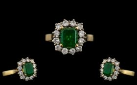18ct Gold Attractive Emerald & Diamond Set Ring marked 750 to interior of shank. The central step-