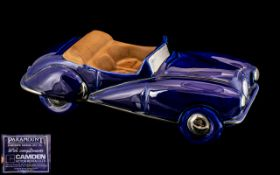 A Paramount (Camden Motors 1953-56) Pottery model of an open topped sports car.