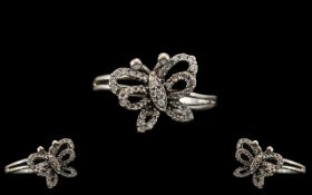 Superb Diamonte Butterfly Ring Set In White 9ct Gold.