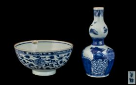 """Blue & White Chinese Antique Decorated Bowl with a floral pattern painted to the body. 6"""" diameter."""