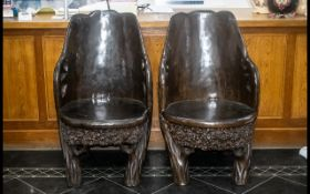 A Pair Of Impressive Carved Dugout Teak Tree Trunk Chairs, Profusely Carved With A Trunk,