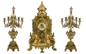 Large Italian Clock Garniture Of Baroque form Flanked by six-light candelabras,