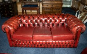 An Ox Blood Leather Chesterfield Sofa. With button back and arms.