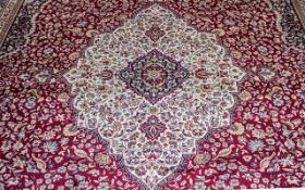 A Genuine Cashmere Large Red Ground Marrakech Carpet/Rug. As new condition. Measures 2.40 by 3.