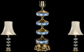 A 20thC Wedgwood Ormolu Mounted Lamp of Unusual Form four tier base raised on brass plinth.