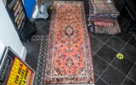 Iranian Terracotta Ground Carpet/Rug Red Ground. Label reads Made in Iran. Measures 290 by 102 cms.