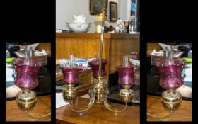 A Three Branch Oil Lamp Chandelier, The Brass Fonts Supported by Shaped Gaselier Arms, Fitted with