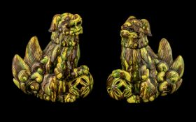 Pair of Antique Chinese Foo Temple Dogs, with an unusual yellow and green splash glaze. Both dogs