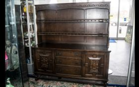 A Stained Oak Priory Dresser And Rack, Of Traditional Form,