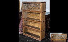 A Modern Style Oak Globe Style Glazed Front Stacking Bookcase,