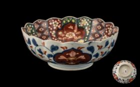 Meiji Period Lobed Shaped Imari Bowl of Typical Palette, with panels decorated with flowers and